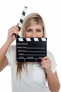 Beautiful Female With Clapperboard